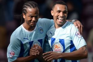 Nathan Delfouneso claimed a vital equaliser against Wolves to secure Coventry's League One status for another season.