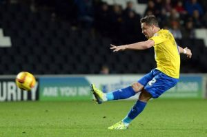 Chris Maguire's two free-kicks secured a fantastic comeback victory in Milton Keynes.
