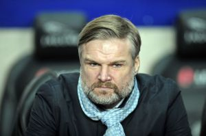Steven Pressley modelling a new scarf in his match-day attire, will a return to sartorial elegance augur a return to form for the Sky Blues?